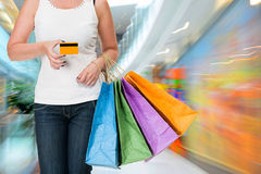 Woman holding shopping bags and credit card Royalty Free Stock Image