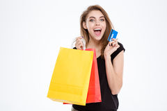 Woman holding shopping bags and credit card Royalty Free Stock Images