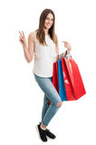 Woman holding shopping bags and doing a peace geasture Royalty Free Stock Photo