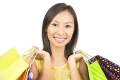 Woman holding shopping bags Stock Photos