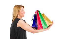 Woman holding shopping bags on her arms Stock Images