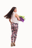 Woman holding shopping bags looking back Royalty Free Stock Photo