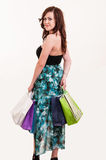 Woman holding shopping bags looking back Stock Photo