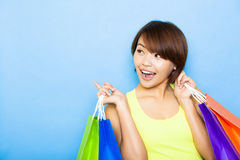 Woman holding shopping bags and looking side Stock Image