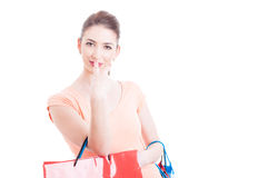Woman holding shopping bags making look into my eyes gesture Royalty Free Stock Image