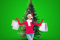 Woman holding shopping bags near christmas tree Stock Photography