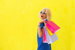 Woman holding shopping bags over her shoulder Stock Photography