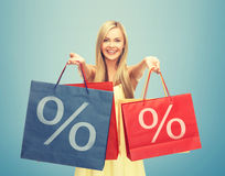 Woman holding shopping bags with percent sign Stock Photos