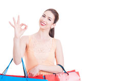Woman holding shopping bags showing all right gesture Royalty Free Stock Photos