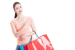 Woman holding shopping bags showing number four with hand Stock Photo