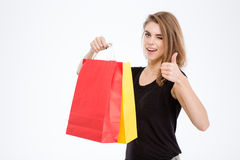 Woman holding shopping bags and showing thumb up Royalty Free Stock Photo