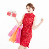 Woman holding shopping bags and smart phone Royalty Free Stock Images