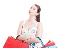 Woman holding shopping bags thinking and looking up Stock Images