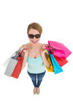 Woman holding shopping bags wearing sunglasses Royalty Free Stock Images
