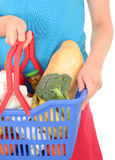 Woman holding shopping basket royalty free stock photo