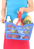 Woman holding shopping basket Stock Photo