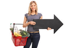 Woman holding shopping basket and an arrow Stock Image