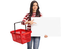 Woman holding a shopping basket and a banner Stock Photo
