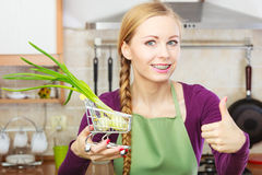 Woman holding shopping cart with chive inside Royalty Free Stock Image