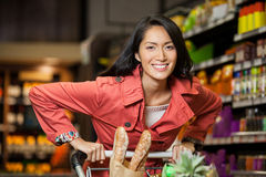 Woman holding shopping cart in organic section Royalty Free Stock Images
