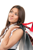 Woman holding shopping gift bags in hand Royalty Free Stock Photo