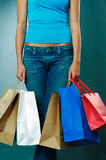Woman holding shopping views. Body of woman holding shopping bags Stock Photos