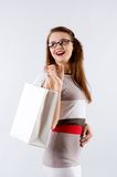 Woman holding shopping white bag Royalty Free Stock Images