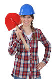 Woman holding a shovel Royalty Free Stock Photography