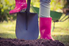 Woman holding shovel Royalty Free Stock Photography