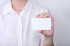 Woman holding with showing card Stock Photo