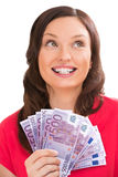 Woman holding and showing five hundred euro banknotes. Woman holding and showing a lot of five hundred euro banknotes on a white isolated background Royalty Free Stock Photo