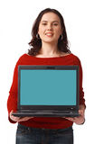 Woman Holding and Showing Open Laptop. Portrait of a pretty young woman holding a laptop standing isolated on white Stock Photos