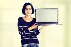 Woman holding and showing screen of 17 inch laptop Royalty Free Stock Photo