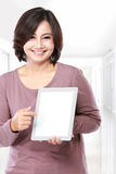 Woman holding and showing tablet computer Royalty Free Stock Photography