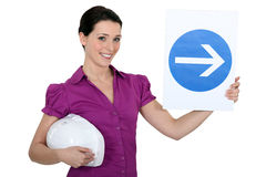 Woman holding sign of Stock Photo