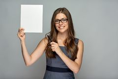 Woman holding sign board and pointing with pen. Smiling woman holding sign board and pointing with pen on banner stock photo