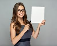 Woman holding sign board and pointing with pen Royalty Free Stock Photography