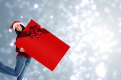 Woman holding a sign with christmas ribbon Stock Photos