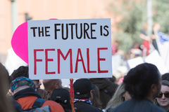 Woman holding sign about female. Los Angeles, USA - January 21, 2017:    Activists holds a sign about Female during Women`s March Los Angeles in Downtown LA Royalty Free Stock Images
