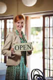 Woman holding a sign with open Stock Images