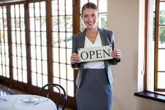 Woman holding a sign with open Royalty Free Stock Photography