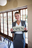 Woman holding a sign with open Royalty Free Stock Image