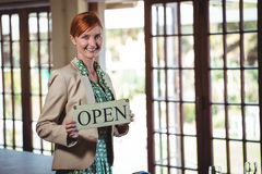 Woman holding a sign with open Stock Photography