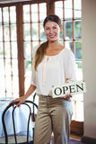 Woman holding a sign with open Royalty Free Stock Photos