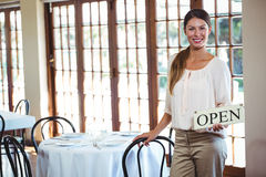 Woman holding a sign with open Stock Photo