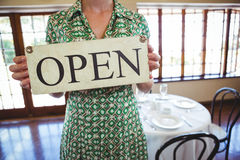 Woman holding a sign with open Royalty Free Stock Images