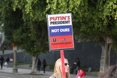 Woman holding sign about Russian president. Los Angeles, USA - January 21, 2017:    Woman holding sign about Russian president during Women`s March Los Angeles Royalty Free Stock Image