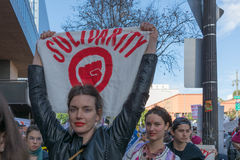 Woman holding sign about solidarity. Los Angeles, USA - January 21, 2017:    Woman holding sign about solidarity during Women`s March Los Angeles in Downtown LA Stock Photography