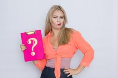 Woman holding signboard with question mark. Studio photoshoot of blonde woman holding signboard with question mark stock image