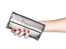 Woman holding silver wallet Royalty Free Stock Photography